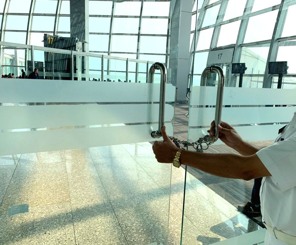 The chained glass door that separates the domestic departure security hold area from the international departure zone at Netaji Subhas Chandra Bose International Airport (NSCBI) in Kolkata.