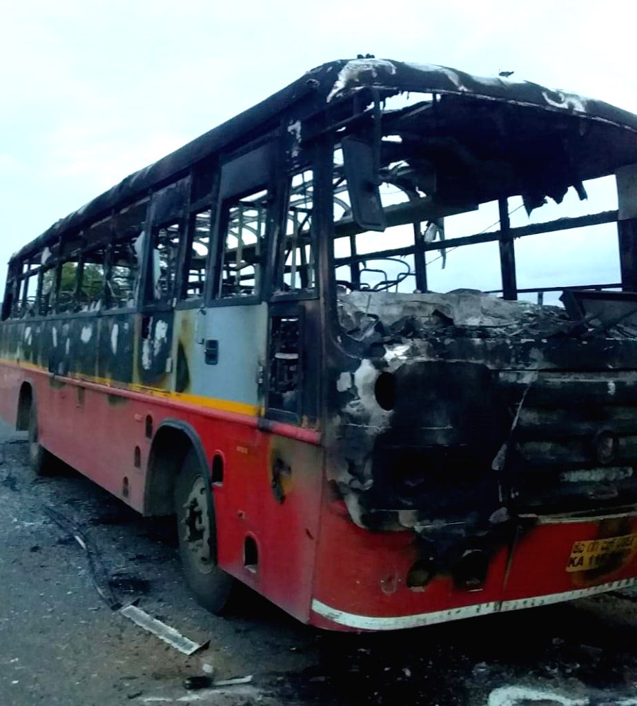 The charred remains of a bus that was set ablaze by the supporters of Karnataka Congress leader D.K. Shivakumar who was arrested on Tuesday evening by the Enforcement Directorate following ...