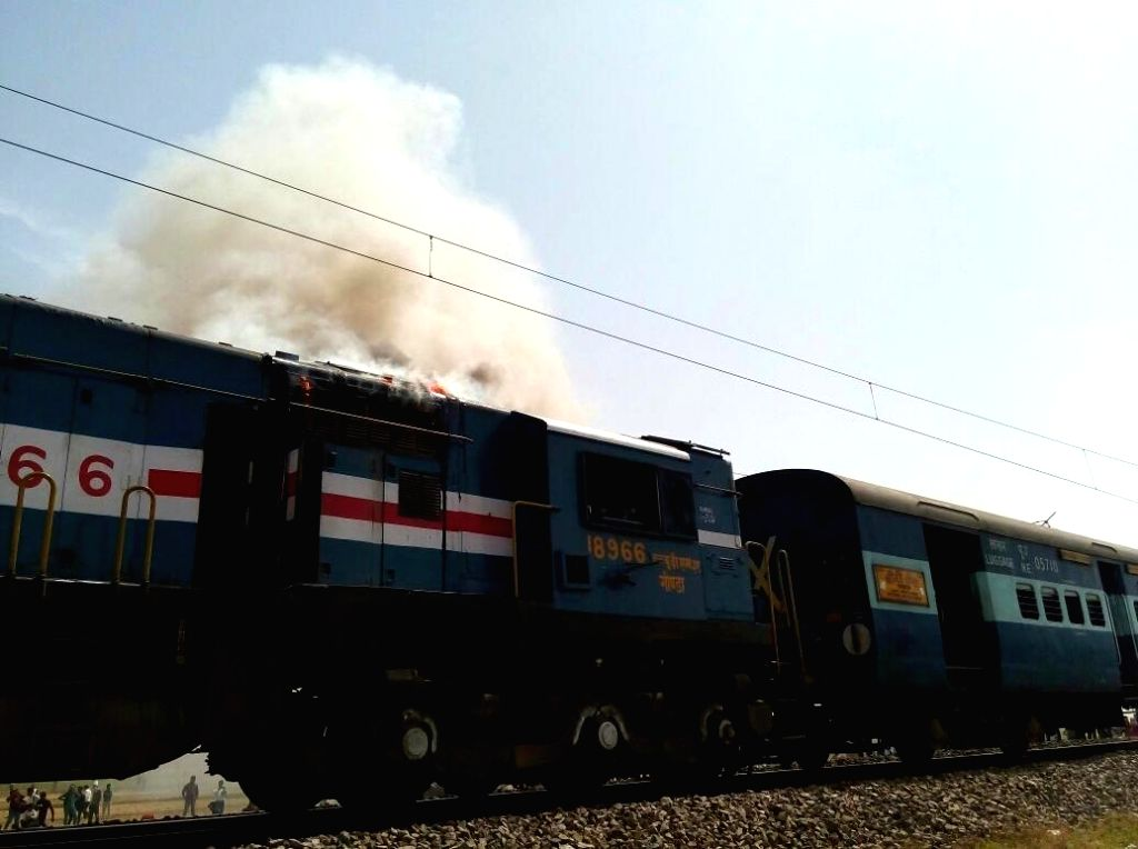 The Chauri Chaura Express engine that caught fire around at the Shujatpur station in Kaushambi district of Uttar Pradesh while on its way from Gorakhpur to Kanpur on April 19, 2016.