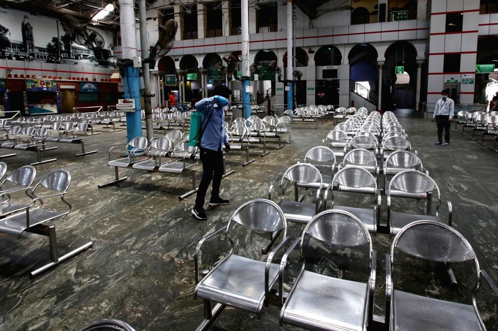 The Chennai Central railway station being sanitised during nationwide shutdown - Janata Curfew - called by Prime Minister Narendra Modi as a measure to contain the spread of COVID-19, on ... - Narendra Modi