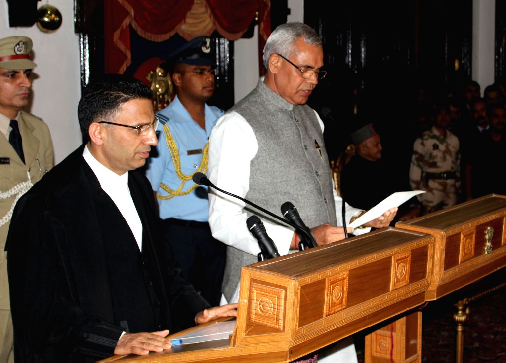 The Chief Justice of Himachal Pradesh High Court Justice Mansoor Ahmad Mir administers the oath of office and secrecy to Acharya Dev Vrat as Governor of Himachal Pradesh at Raj Bhawan in ...