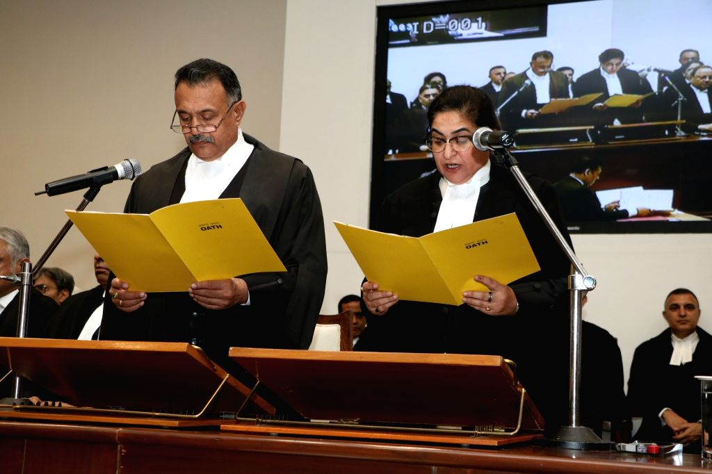 The Chief justice of Punjab & Haryana High Court, Justice Ravi Shanker Jha administers the oath of office to Justice Alka Sarin as Punjab and Haryana High Court judge, in Chandigarh ...