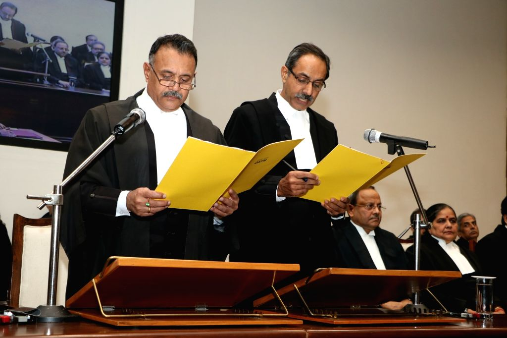 The Chief justice of Punjab & Haryana High Court, Justice Ravi Shanker Jha administers the oath of office to Justice Subir Sehgal as Punjab and Haryana High Court judge, in Chandigarh ...
