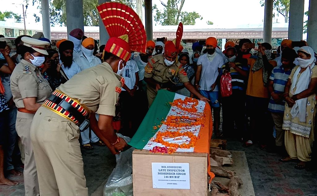 The coffin carrying the mortal remains of Inspector Mahendra Singh Bhatti, who was killed in a bullet firing by a BSF constable while the former was patrolling, near the Indo-Bangladesh ... - Mahendra Singh Bhatti