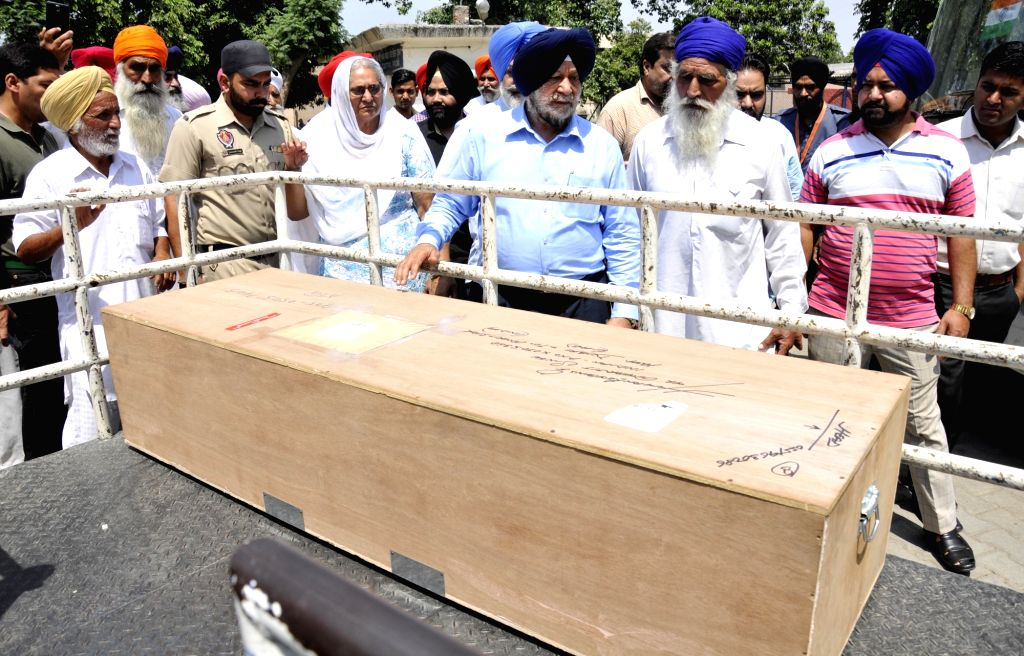 The coffin of Amarjit Singh, who was on the death row in a murder case arrives in Amritsar on May 12, 2017. He died of heart attack on 3rd May 2017. - Amarjit Singh