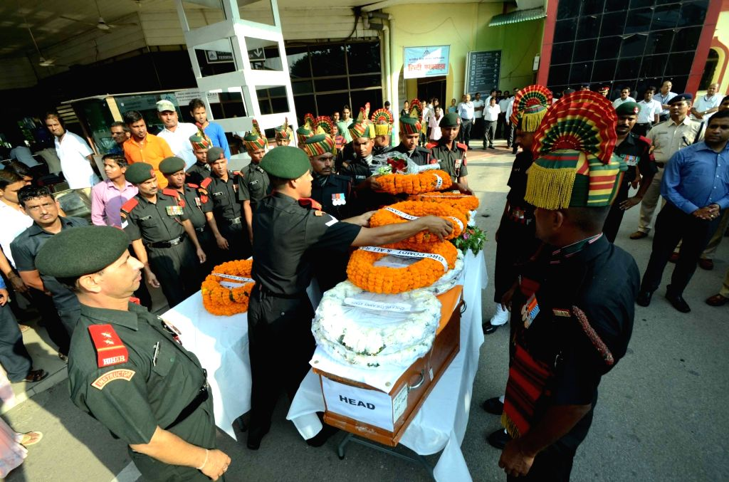 The coffins of martyr Raj Kishore Singh of the Bihar Regiment who succumbed to his injuries sustained during Uri terror attack at the Army Research and Referral hospital in New Delhi, arrives ... - Kishore Singh