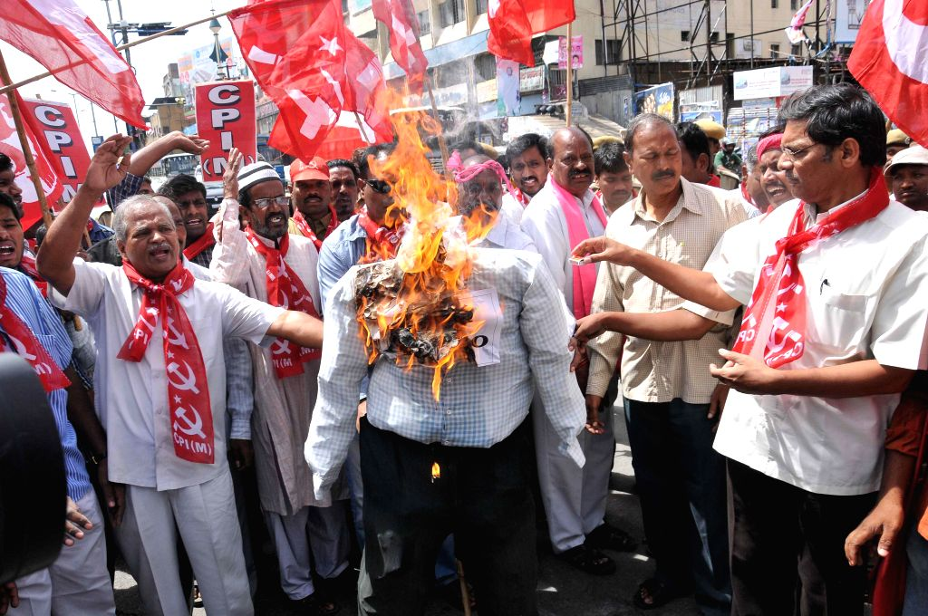 The communists and Telangana Joint Action Committee (TJAC) activists demonstrate against passage of Polavaram bill in Lok Sabha for merger of over 200 villages of Telangana with Andhra Pradesh in ...