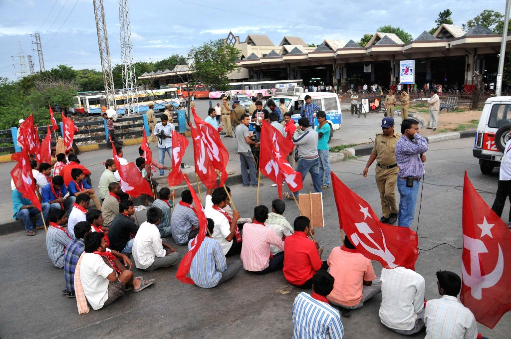 The communists demonstrate against passage of Polavaram bill in Lok Sabha for merger of over 200 villages of Telangana with Andhra Pradesh at Hyderabad Bus Depot on July 12, 2014.