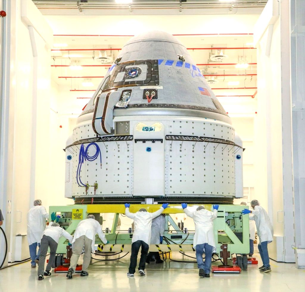 The CST-100 Starliner spacecraft, to be flown on Boeing???s Orbital Flight Test (OFT), undergoing launch preparations inside the Commercial Crew and Cargo Processing Facility at Kennedy Space Center ...