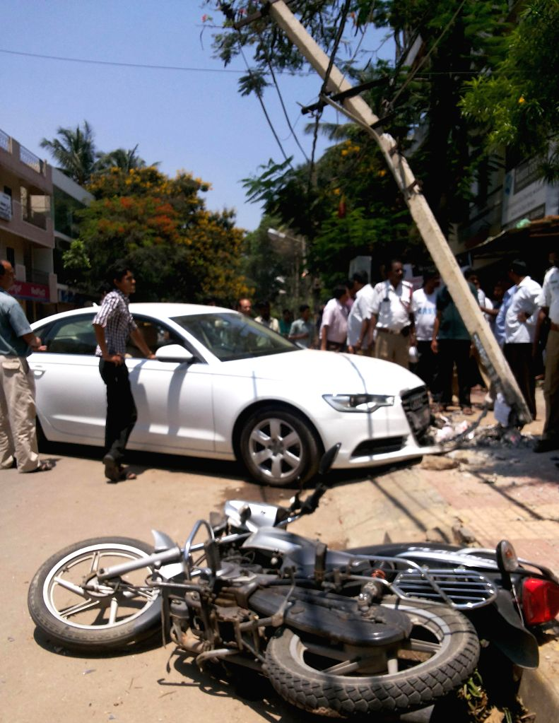 The damaged car and bike after an accident at BTM Layout in Bangalore on April 20, 2014. The biker was injured in the accident.