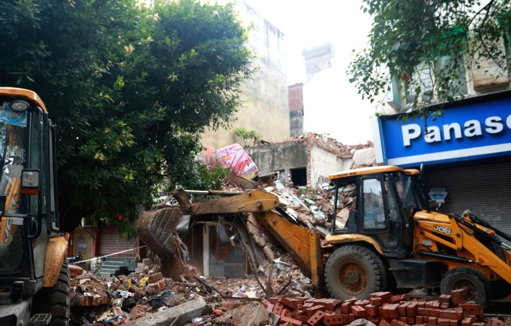 The debris of a portion of a four storied building that collapsed in Delhi' Laxmi Nagar being cleared on July 2, 2017.