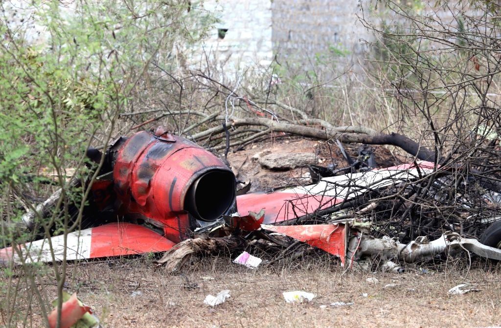 The debris of Hawk MK 132 aircraft of Indian Air Force's Surya Kiran display team that crashed after a mid-air collision while rehearsing for upcoming  'Aero India 2019' air show near the ...