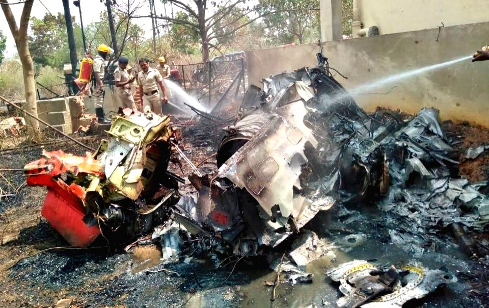 The debris of two Hawk MK 132 aircraft of Indian Air Force's Surya Kiran display team that crashed after a mid-air collision while rehearsing for upcoming  'Aero India 2019' air show near ...
