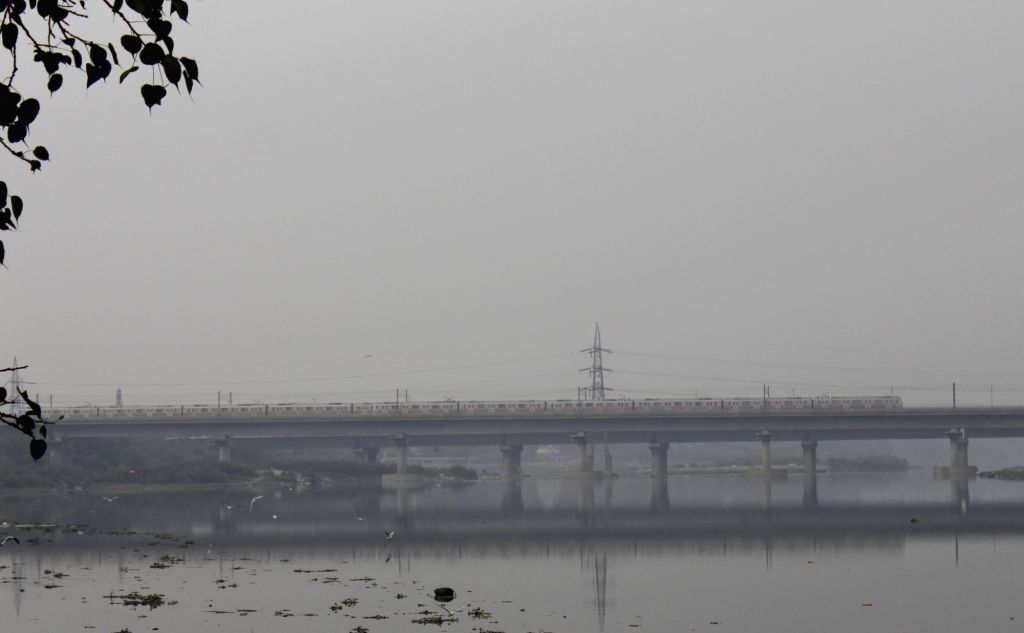 The Delhi metro chugging over the Yamuna river and through the smog that engulfs the national capital on a chilly winter morning, in New Delhi on Nov 24, 2020.
