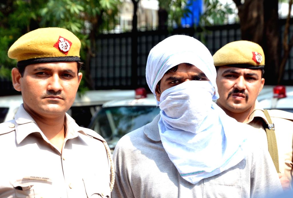 The Delhi police has apprehended a wanted gangster involved in murder and robbery cases taken to be produced at the police headquarters in New Delhi on June 29, 2015.