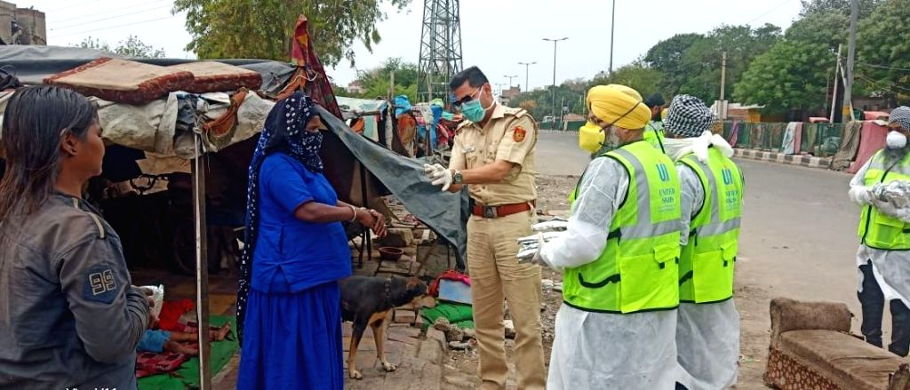 The Delhi Police personnel distribute food and other essentials among the people living in quarantine camps, on Day 2 of the 21-day nationwide lockdown imposed by the Narendra Modi government over ... - Narendra Modi
