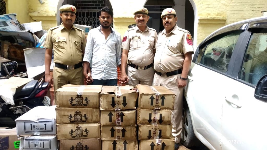 The Delhi Police seized cartons of illicit liquor from a four-wheeler during frisking in Delhi's Gandhi Nagar, on July 17, 2019.