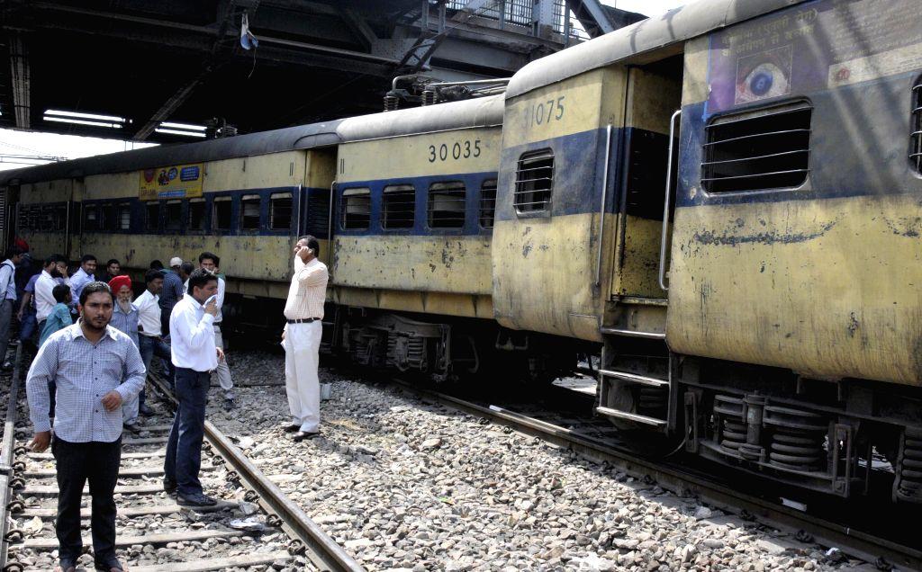The derailed bogies of Amritsar-Ambala DMU train outside Amritsar railway station on May 5, 2014.