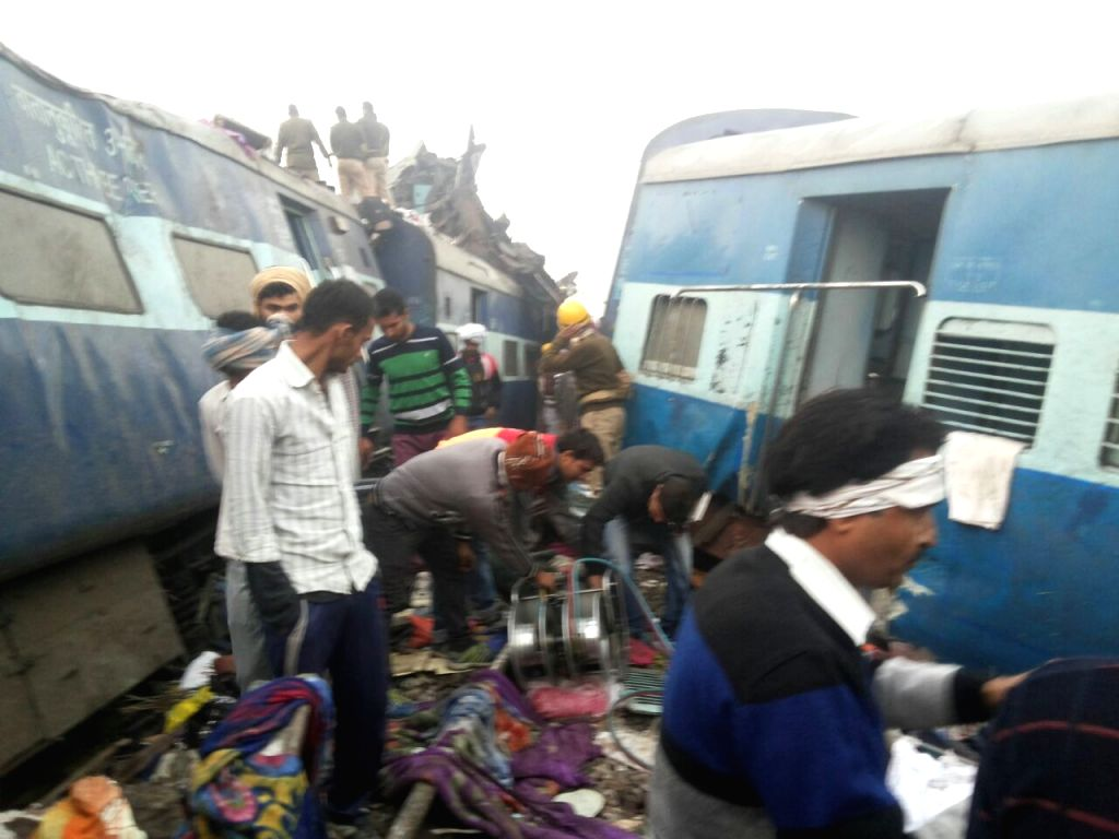 The derailed coaches of Indore-Patna Express near Pukhraya station, about 60 km from Kanpur on Nov 20, 2016. At least 96 people were killed and more than 150 injured when 14 coaches of the ...