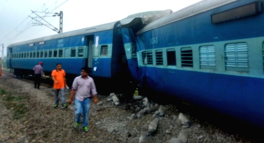 The derailed coaches of Jhelum Express in Ludhiana of Punjab on Oct 4, 2016. At least three persons were injured when 10 coaches of the train around 3.10 a.m. between Ludhiana and Phillaur ...