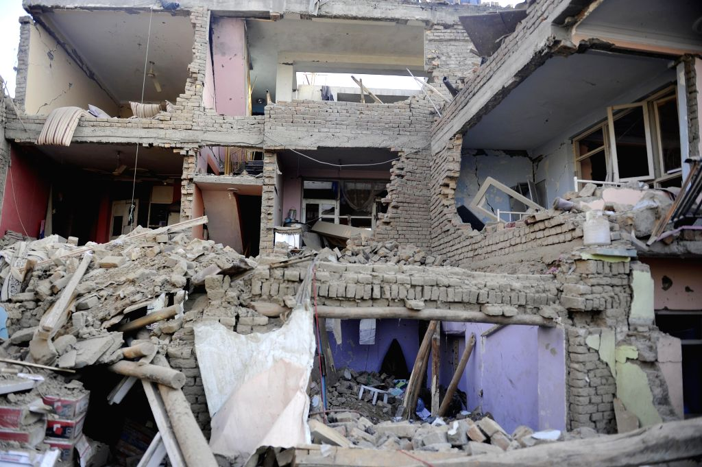 The destroyed houses are seen after a blast in Kabul, capital of Afghanistan, Aug. 7, 2015. At least 8 civilians were killed and nearly 400 other wounded in a truck ...