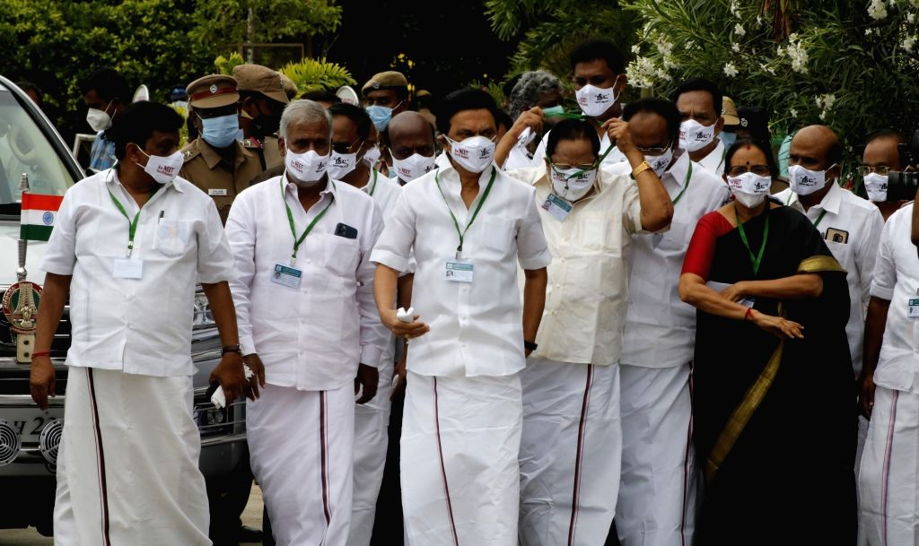 The DMK Legislators, including party President M. K.Stalin wear a white mask with slogan against the National Eligibility-cum-Entrance Test (NEET) on it as they arrive to attend the ...