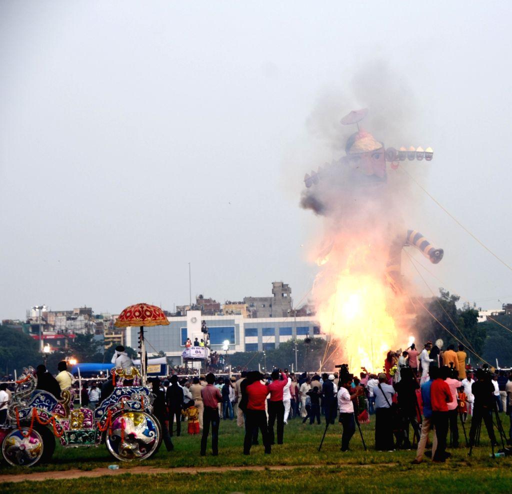 The effigy of Ravana being burned at 'Ramleela Mahotsav' during Dussehra celebrations in Patna, on Oct 8, 2019.