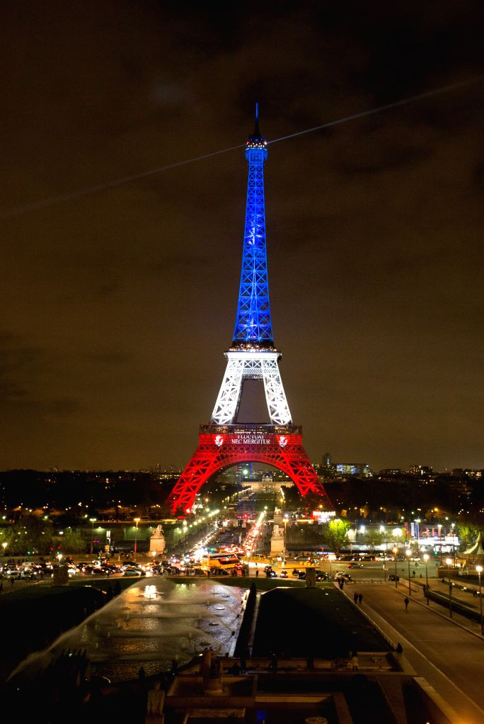 The Eiffel Tower is lit with the blue, white and red colours of the French flag in Paris, France, Nov. 16, 2015, to pay tribute to the victims of the terror attacks ...
