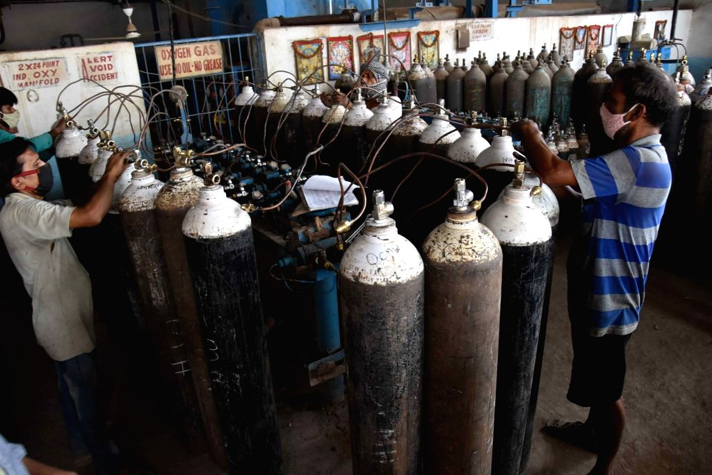 The employees refilling cylinders at a medical oxygen plant, in Patna On Saturday, 08 May, 2021.