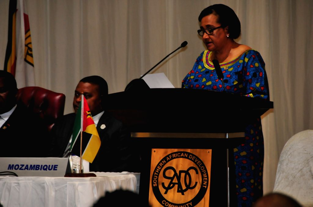 The Executive Secretary of Southern African Development Community (SADC) Stergomena Lawrence Tax addresses the annual SADC summit in Gaborone, Botswana on Aug. 18, ...