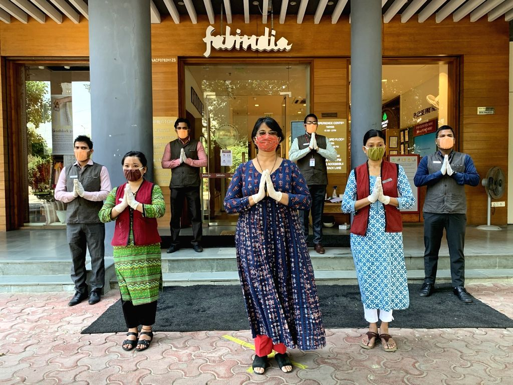 The Fabindia staff, ready to welcome customers back to the store. (Photo Courtesy: Fabindia)