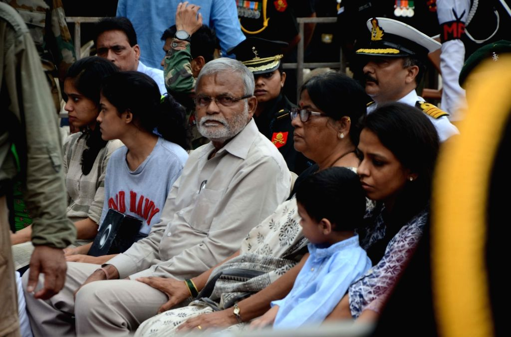 The family members of Major Kaustubh P. Rane, including his father Prakash Rane, mother Jyoti, sister Kashyapi, wife Kanika and minor son Agastya, at a ceremony where people paid homage to his ...
