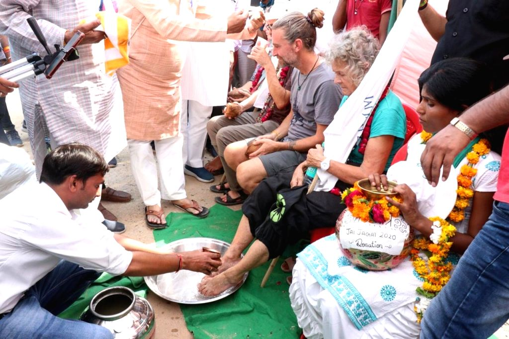 The feet of Gandhi followers were washed as a welcome gesture.
