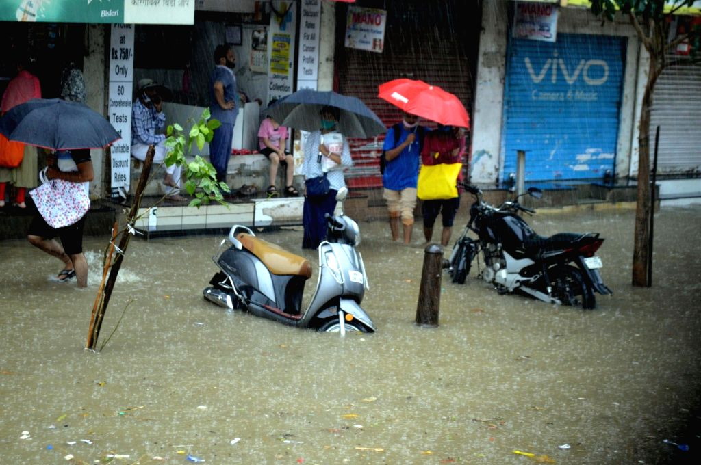 The first monsoon rains hit  Mumbai with full fury on Wednesday, hitting local trains and road traffic, waterlogged and flooding low-lying areas  in Mumbai on Wednesday, 09 June  2021 (Photo ...