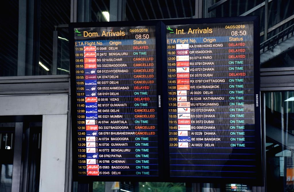 The flight information display system (FIDS) at the Netaji Subhash Chandra Bose International Airport, in Kolkata on May 4, 2019. After hours of closure due to severe cyclonic storm Fani, ...