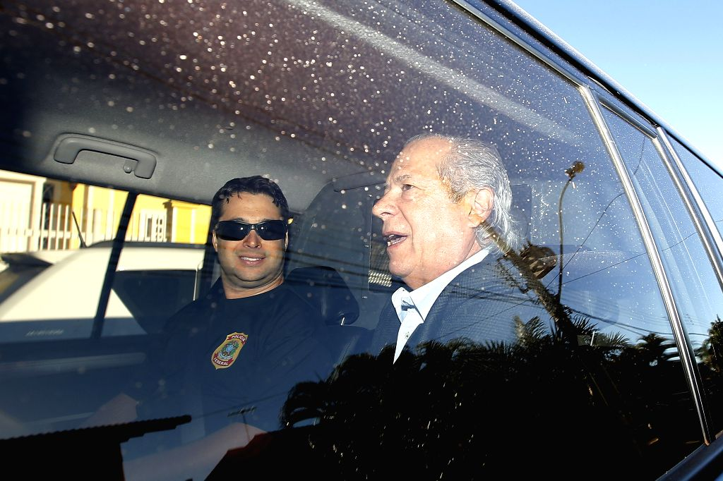 The former Minister Chief of Cabinet of Brazil, Jose Dirceu (R), reacts in a patrol car after his arrest, in Brasilia, Brazil, on Aug. 3, 2015. The former Minister ... - Chief