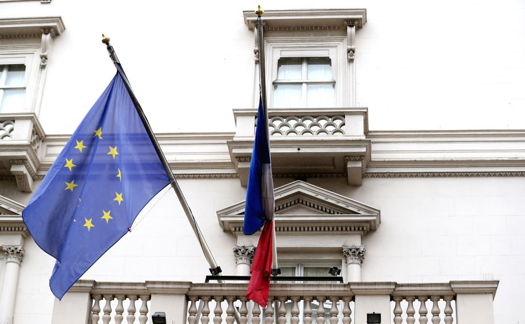The French national flag flies at half mast at the French Embassy in London, Great Britain, to mourn the victims of a series of attacks in Paris, on Nov. 14, 2015. ...