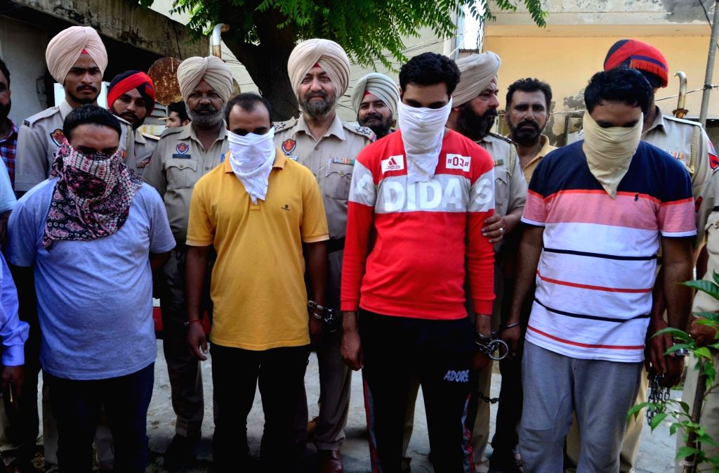 The gang of robbers from which the police recovered money and weapons worth lakhs that they had burgled from Majitha branch of Canara Bank, in police custody, in Amritsar on Sept 8, 2018.