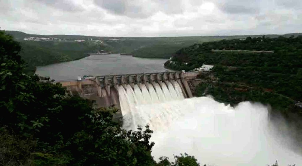 The gates of the Srisailam reservoir were lifted releasing 2.2 lakh cusecs of water that made its way to the Nagarjunsagar dam downstream, after the dam reached its full capacity following ...