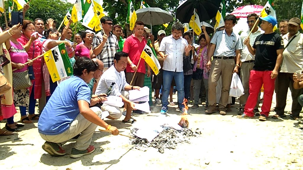 The Gorkha Janmukti Morcha (GJM) supporters burning the Gorkhaland Territorial Administration (GTA) Agreement during a rally in Dagapur, Siliguri on June 27, 2017.