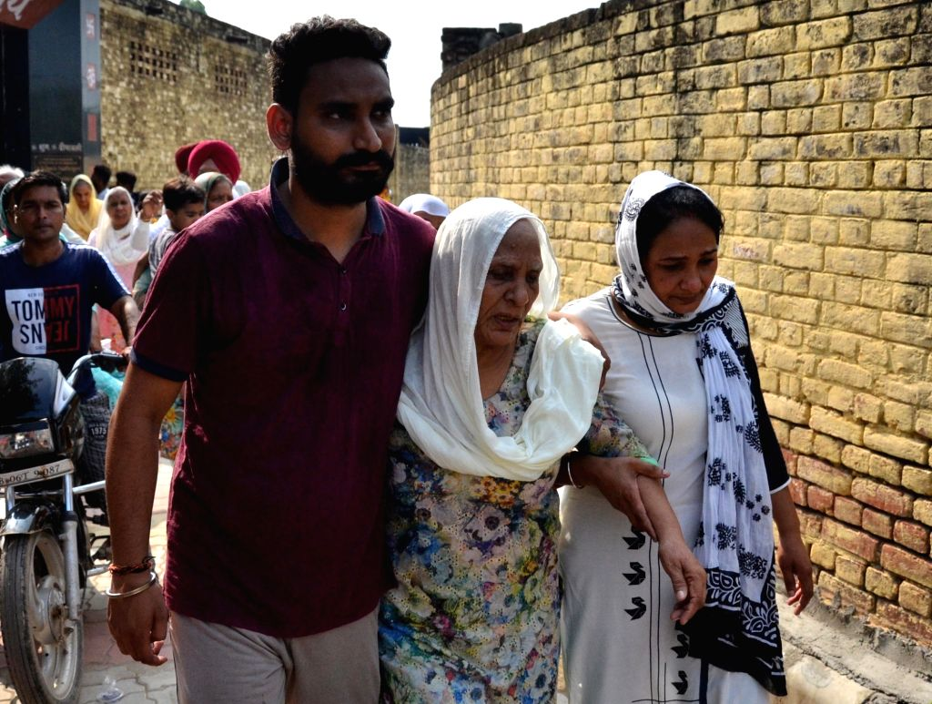 The grief struck relatives of those who lost their lives in Gurdaspur factory fire at the funeral rites at Batala in Punjab's Gurdaspur, on Sep 5, 2019. At least 21 people were killed and 26 ...