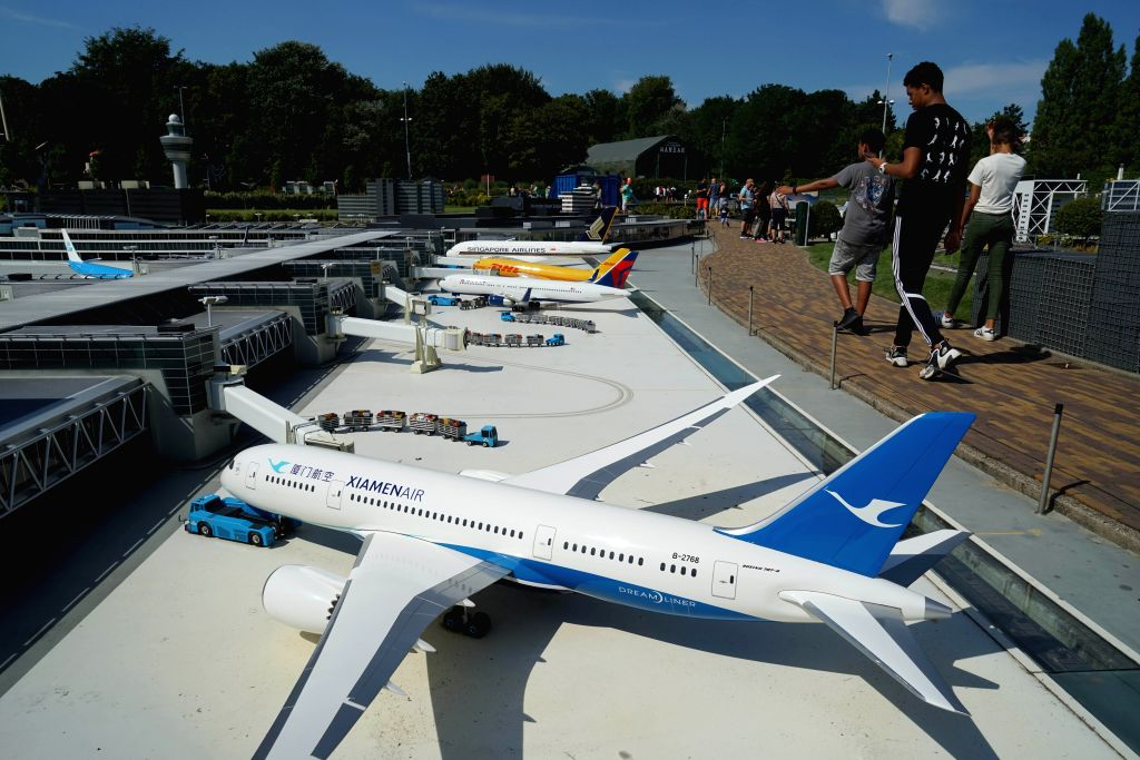 THE HAGUE, Aug. 26, 2019 - Visitors view miniature planes at the miniature park Madurodam in The Hague, the Netherlands, Aug. 25, 2019. Madurodam is a miniature park and tourist attraction in The ...