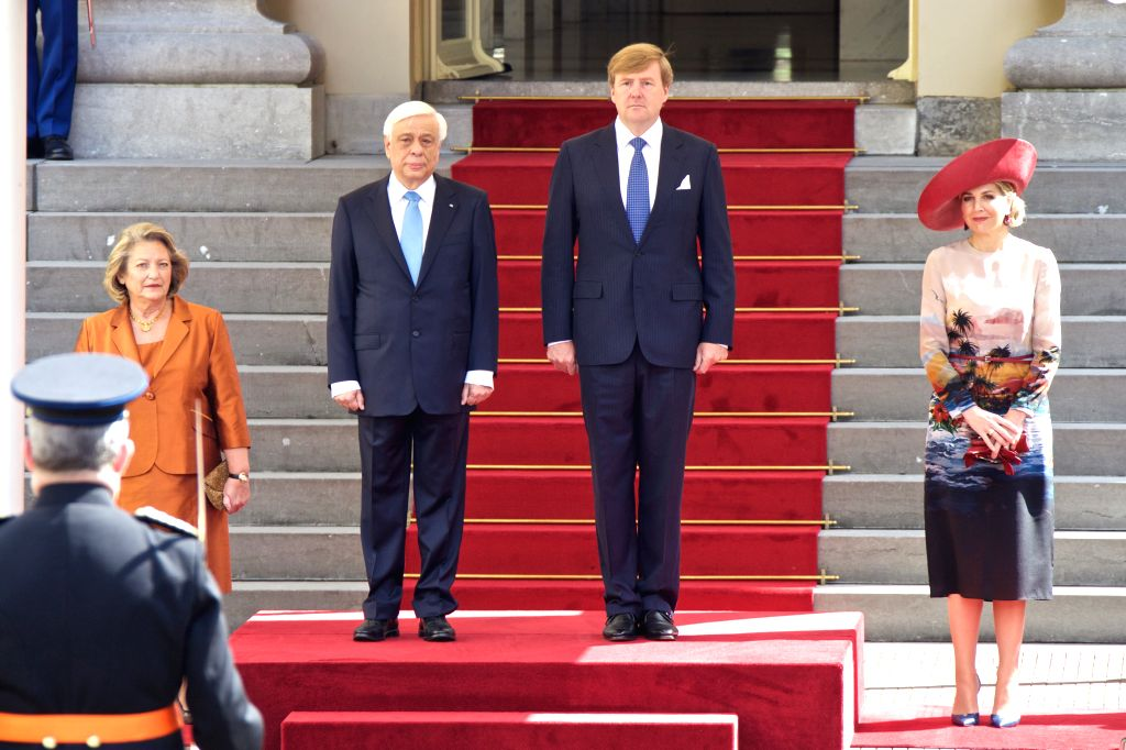 THE HAGUE, July 4, 2016 - Dutch King Willem-Alexander (2nd R) and Queen Maxima (1st R) receive Greek President Prokopis Pavlopoulos (2nd L) and his wife at Noordeinde Palace in the Hague, the ...