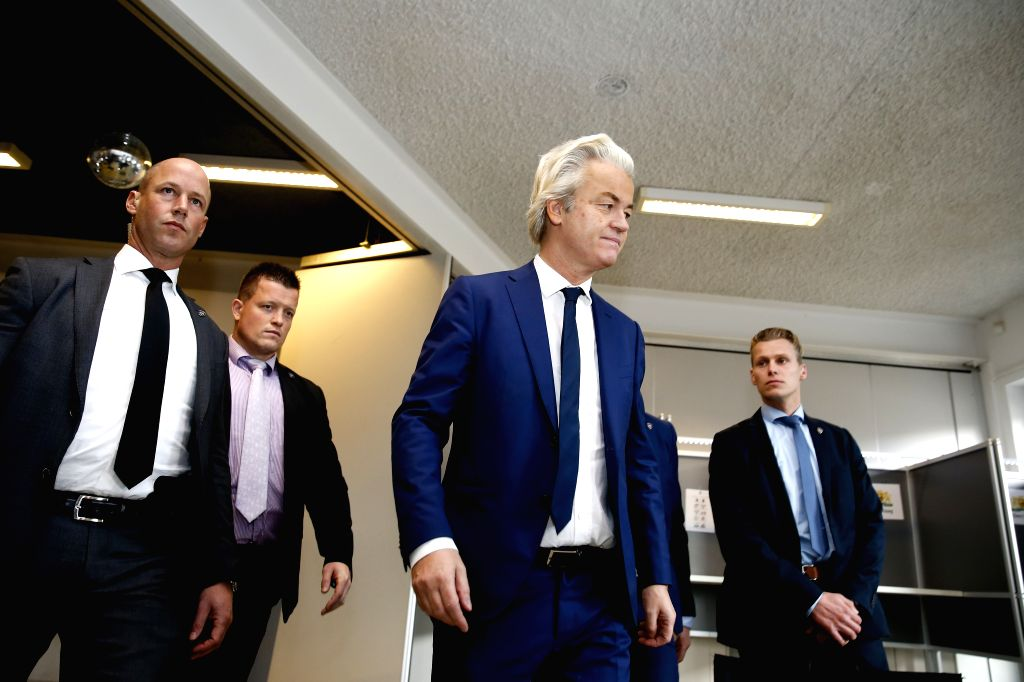 THE HAGUE, March 15, 2017 - Far-right Party for Freedom (PVV) leader Geert Wilders (C) leaves after casting ballot at a polling station in the parliament elections in The Hague, the Netherlands, ...