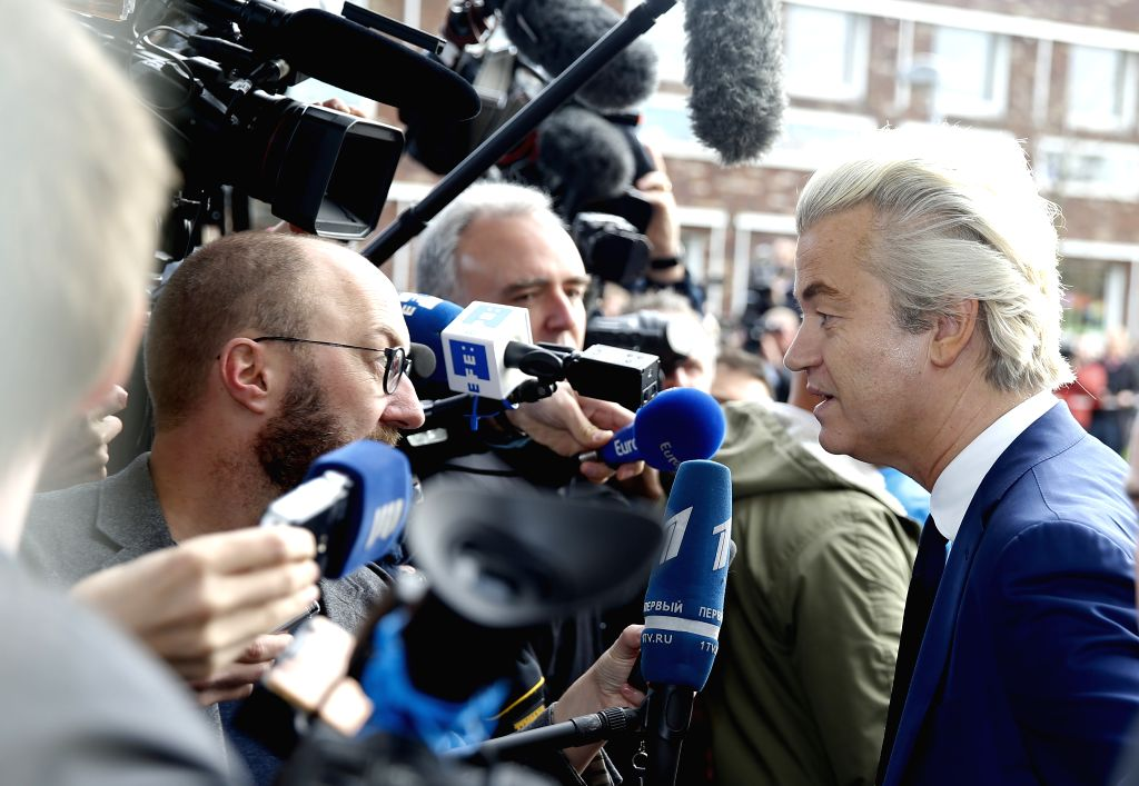 THE HAGUE, March 15, 2017 - Far-right Party for Freedom (PVV) leader Geert Wilders (R) speaks to the media after casting ballot in the parliament elections at a polling station in The Hague, the ...