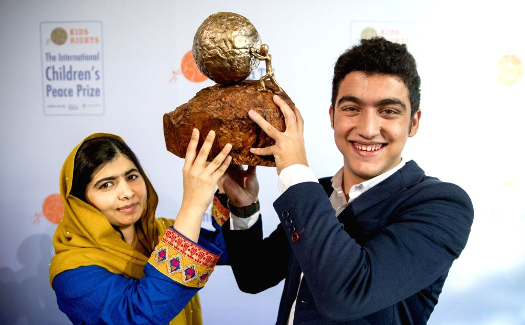 The Hague: Mohamad al Jounde from Syria receives the International Children's Peace Price from Malala Yousafzai in The Hague on Dec. 4, 2017. (Photo Courtesy: Jerry Lampen/KidsRights)