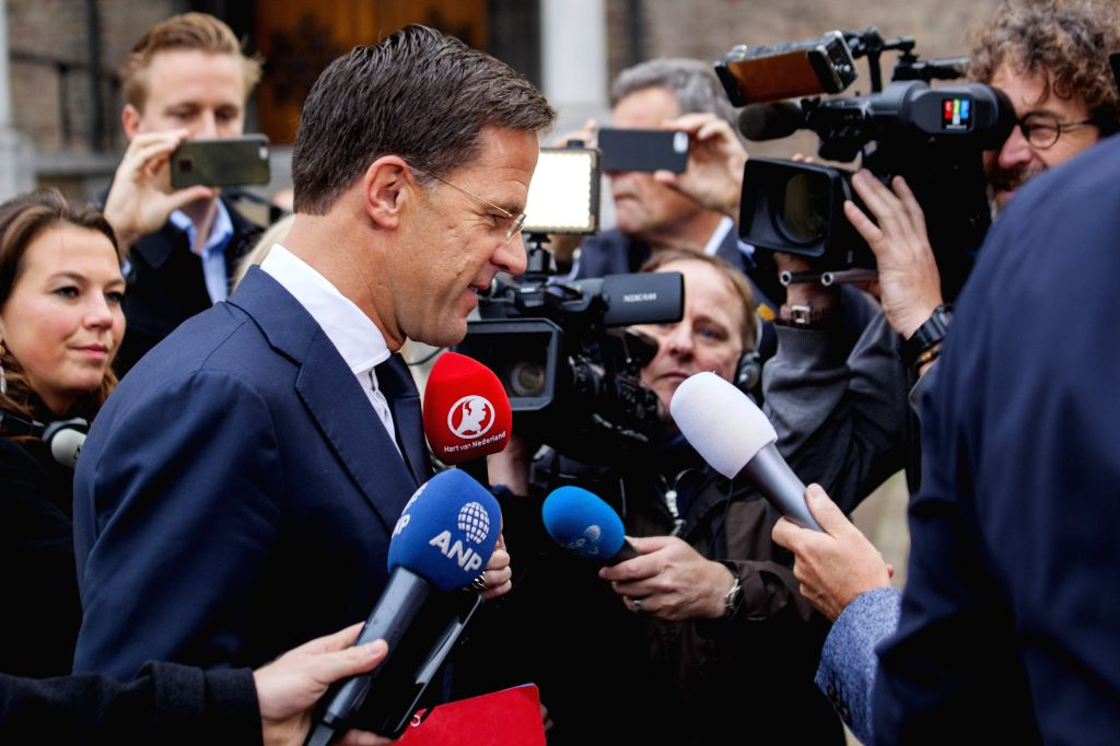 THE HAGUE, Oct. 10, 2017 - Mark Rutte (front), Dutch Prime Minister and leader of the rightist liberals VVD, talks to journalists in The Hague, the Netherlands, Oct. 10, 2017. The parliamentary ... - Mark Rutte