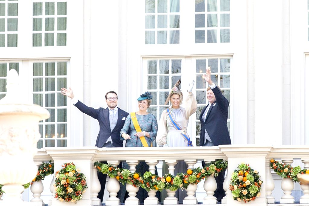 THE HAGUE, Sep. 18, 2018 - Dutch King Willem-Alexander, Queen Maxima, Princess Laurentien and Prince Constantijn (R to L) wave to people on the balcony of Noordeinde Palace on the Prince's Day in The ...