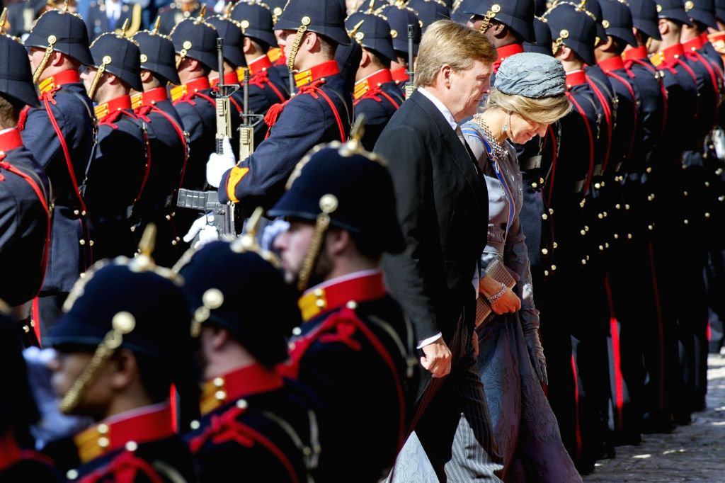 """THE HAGUE, Sept. 19, 2017 - Dutch King Willem-Alexander (C) and Queen Maxima walk into the Hall of Knights (Ridderzaal) where the King will open the parliamentary year by reading the """"Speech ..."""