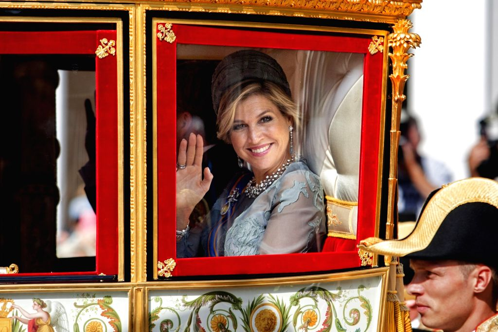 THE HAGUE, Sept. 19, 2017 - Dutch Queen Maxima waves hands in the Glass Coach as she arrives at the palace Noordeinde in The Hague, the Netherlands, Sept. 19, 2017. The traditional opening of the ...